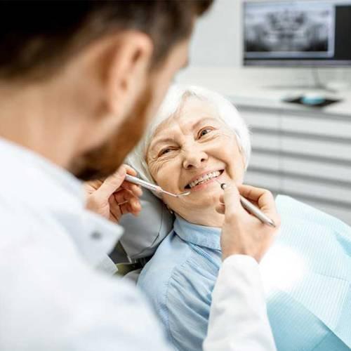 family dentist Preston One Dental Studio Dallas TX services dentures bridges